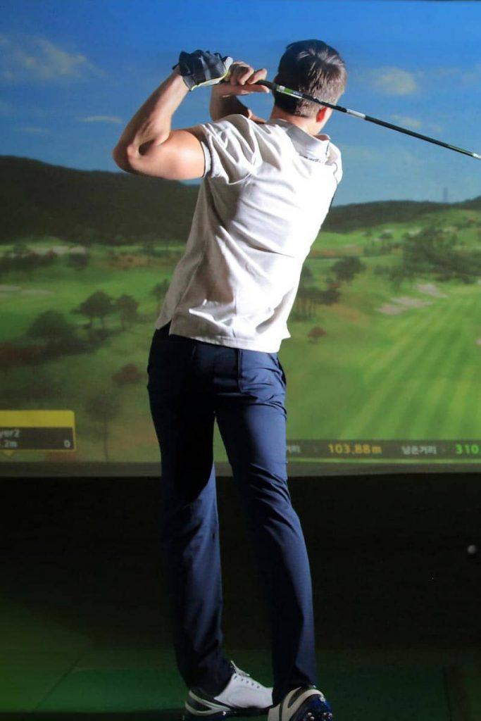 Man playing Golf Simulator in Thailand