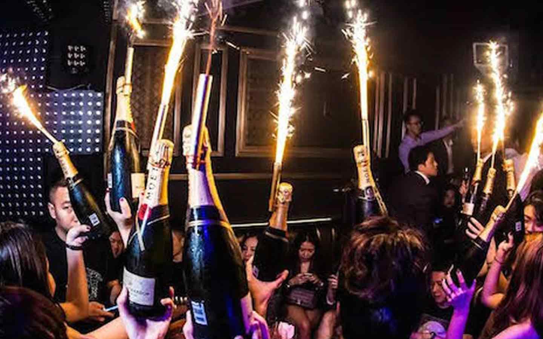 VIP service bringing Champagne at VIP table at a nightclub in Bangkok