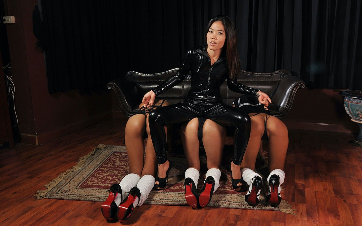 Thai mistress with female slaves at a bdsm and fetish club in Bangkok