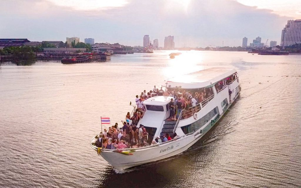 boat party in Bangkok on the chao Phraya river during the sunset