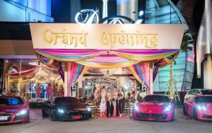 entrance of Dubai Luxury Club in Bangkok with luxury cars and beautiful Thai models