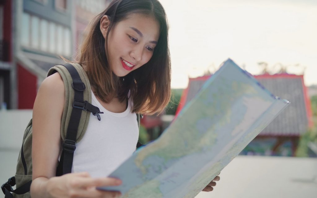 female tour guide in Bangkok with a map