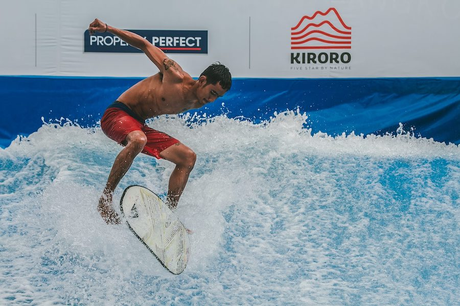 Thai guy doing a flip at flow house Bangkok artificial wave
