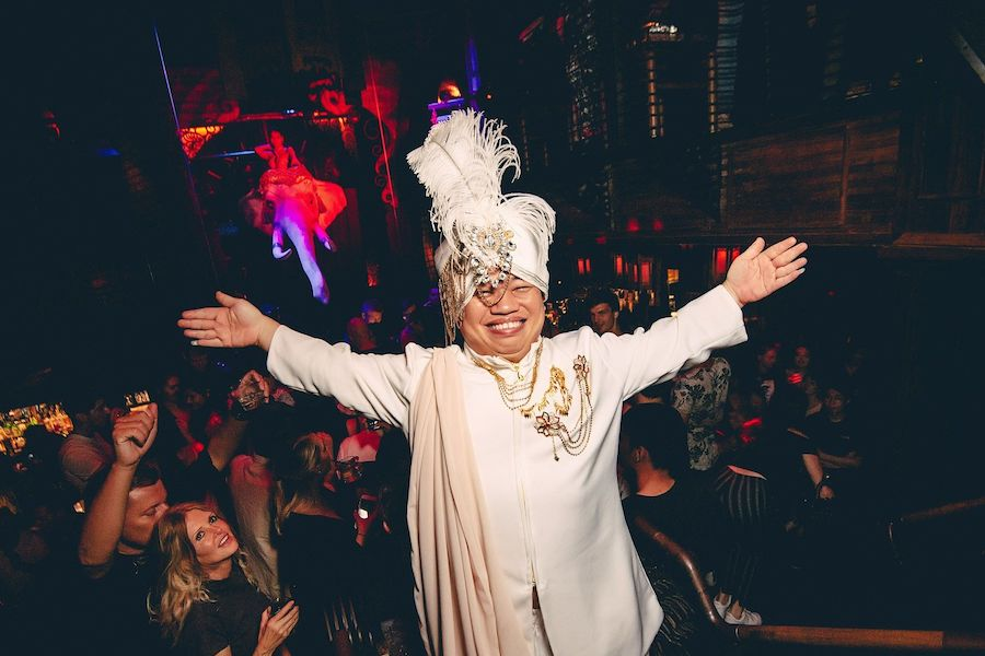 midget with a sultan costume at a club in Bangkok