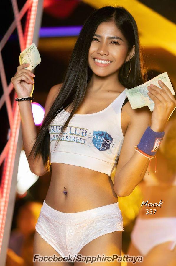 Thai bar girl holding money in a gogo bar in Pattaya