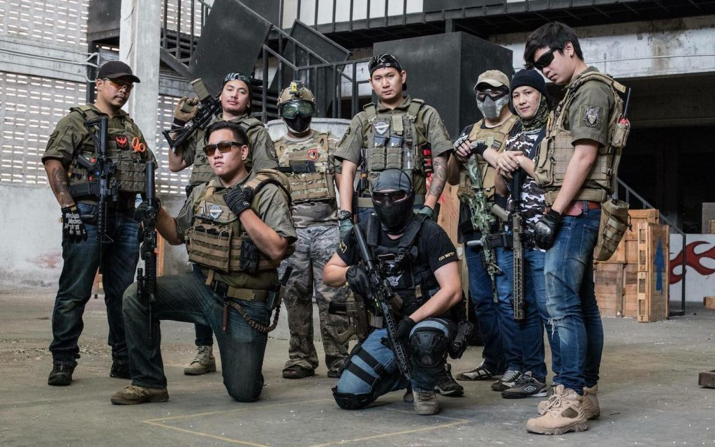 airsoft players in Bangkok wearing military gear at At One Airsoft Fields