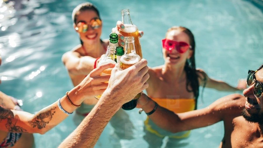 people drinking in a pool