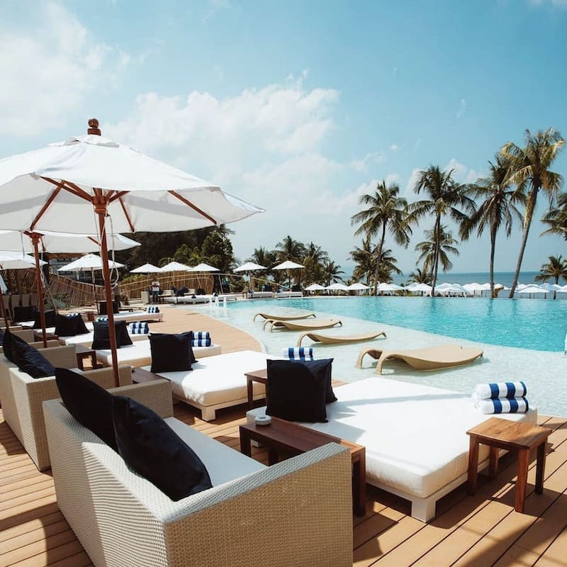seats by the pool at Alexa Beach club in Pattaya