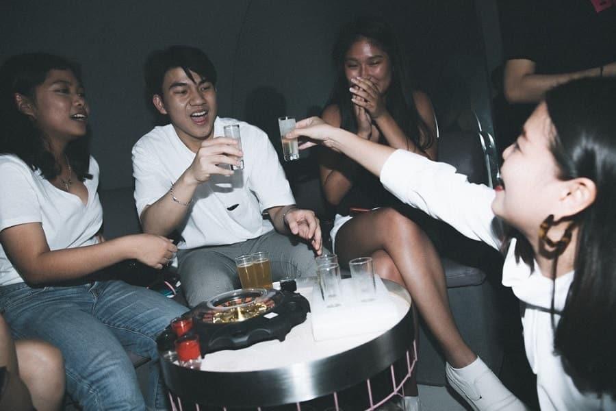 people drinking shots at BEAM Bangkok
