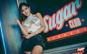 sugar club bangkok sign with Thai girl
