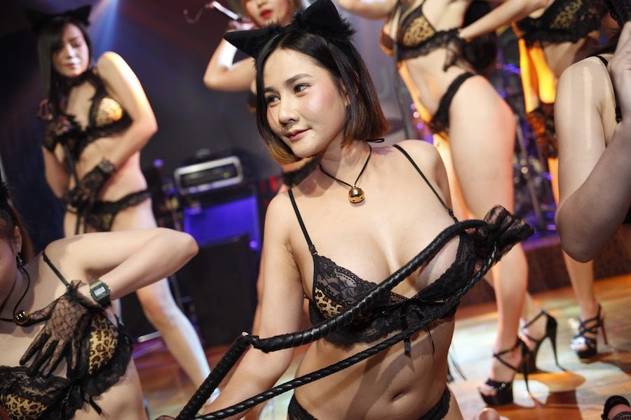 Thai girls in black lingerie with a whip