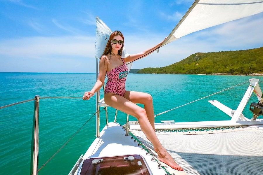 Thai model posing on a beautiful catamaran in Pattaya