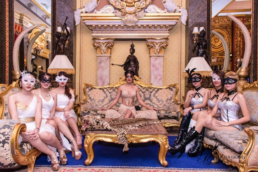 Thai models with masquerade masks at Pegasus gentlemen club in Bangkok